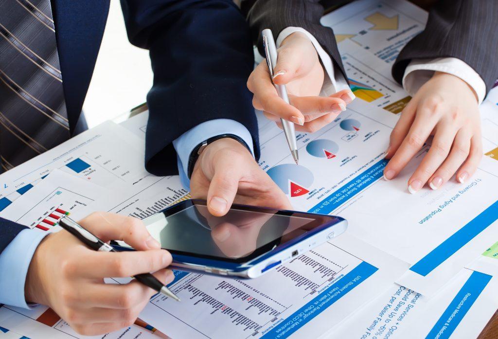 businessmen doing financial forecasting