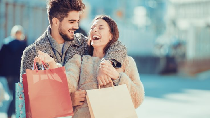 happy couple after holiday shopping