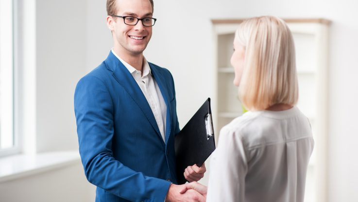 custom broker shaking hands with client