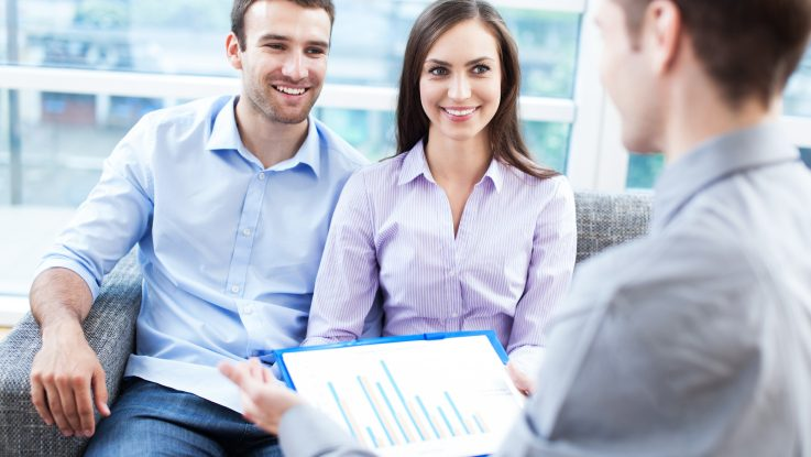 A couple consulting a financial adviser