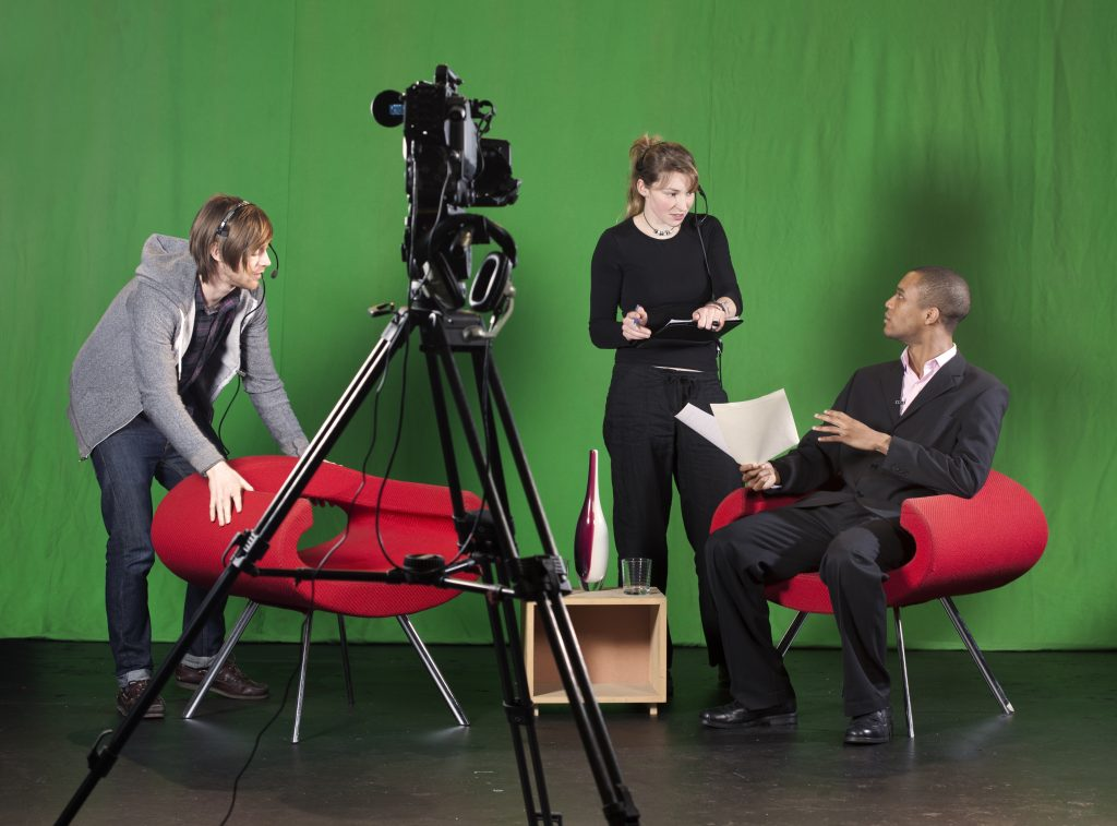 People filming for a corporate event