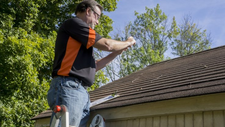 Homeowner picturing the hole in his roof
