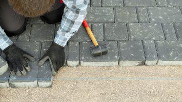 Landscaper building a pathway