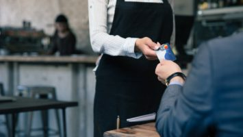 Man handing over credit card for payment