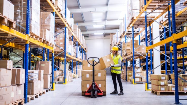 Female worker at a packaging warehouse