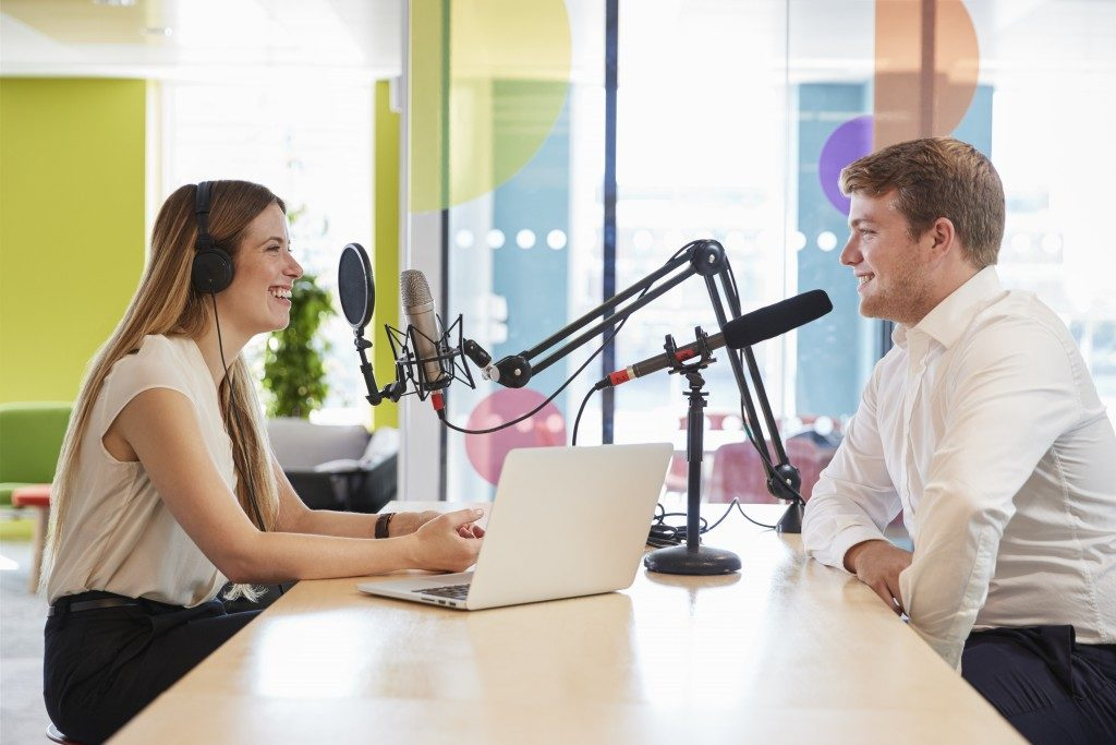 Young woman and a doctor having podcast session