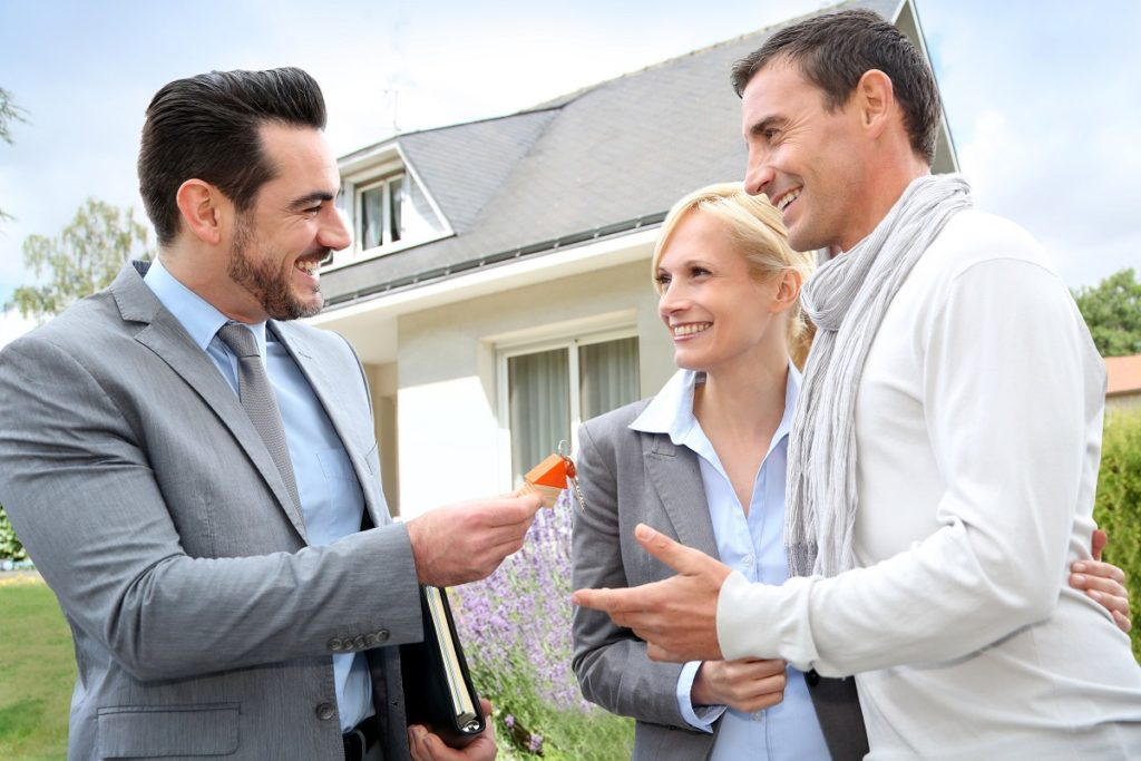 Agent handing over keys to the property owners