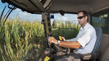 Man driving in the cornfield
