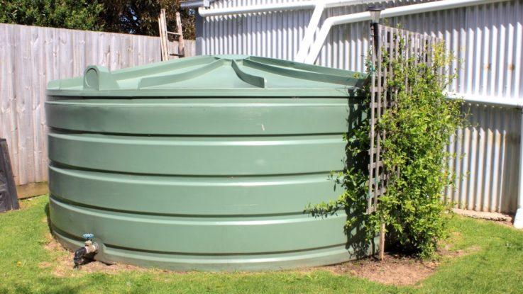 Large green rainwater tank