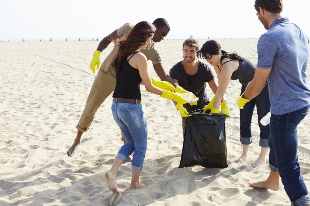 Volunteers picking up trash on the beach