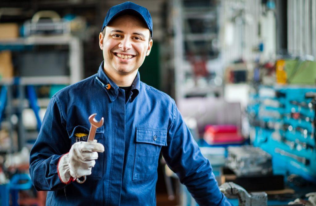 Car mechanic smiling