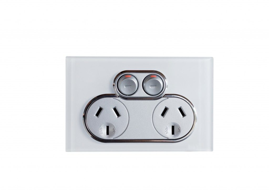Electric socket on white background