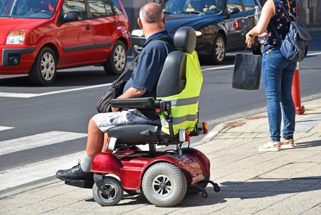 Man with electric wheelchair