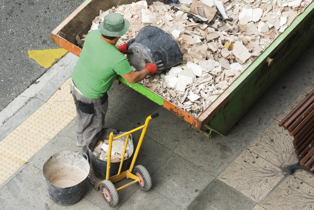 man loading construction waste