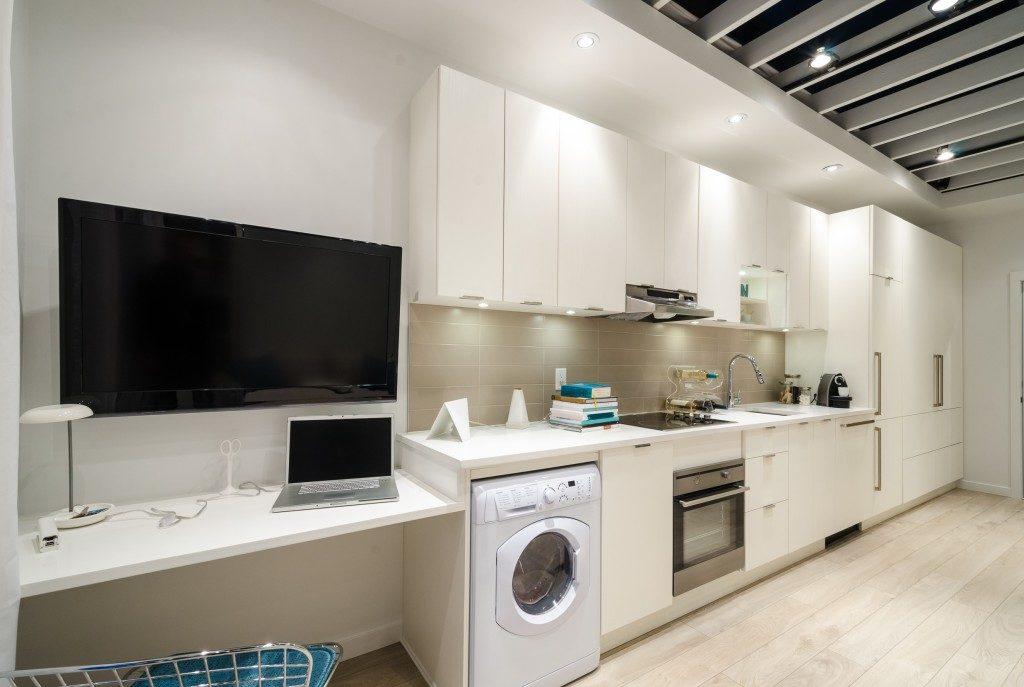 modern kitchen using smart appliances