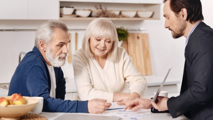 Senior couple with an insurance agent