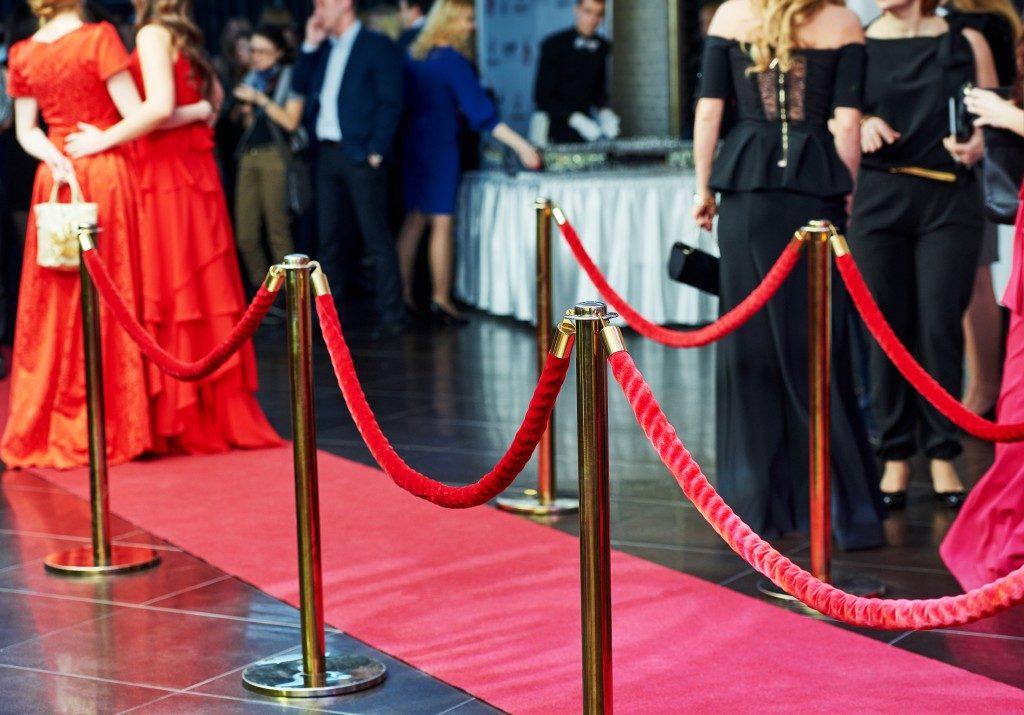 people walking in red carpet