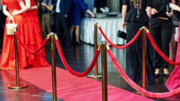 people walking in red carpet