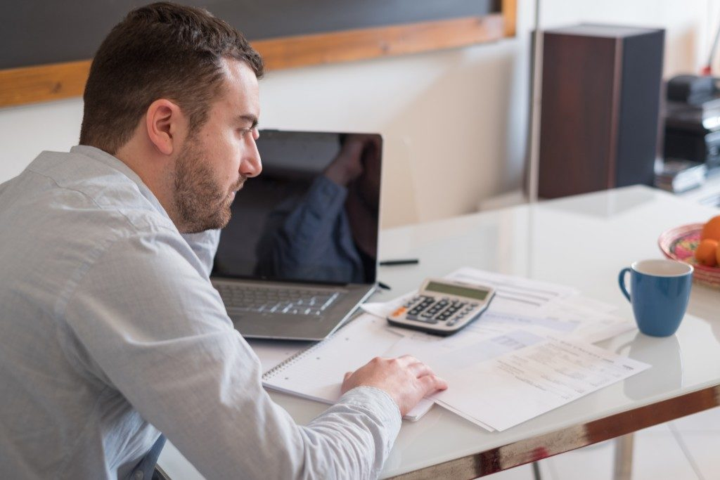 Businessman reviewing taxes