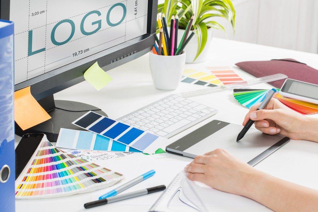 Artist designing a logo