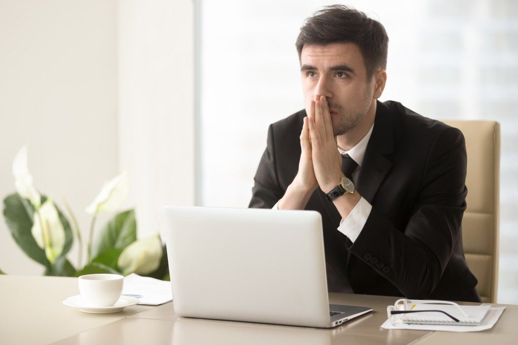 businessman thinking deeply