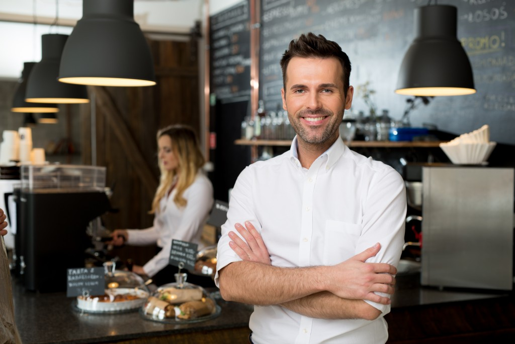 Successful small business owner standing with crossed arms