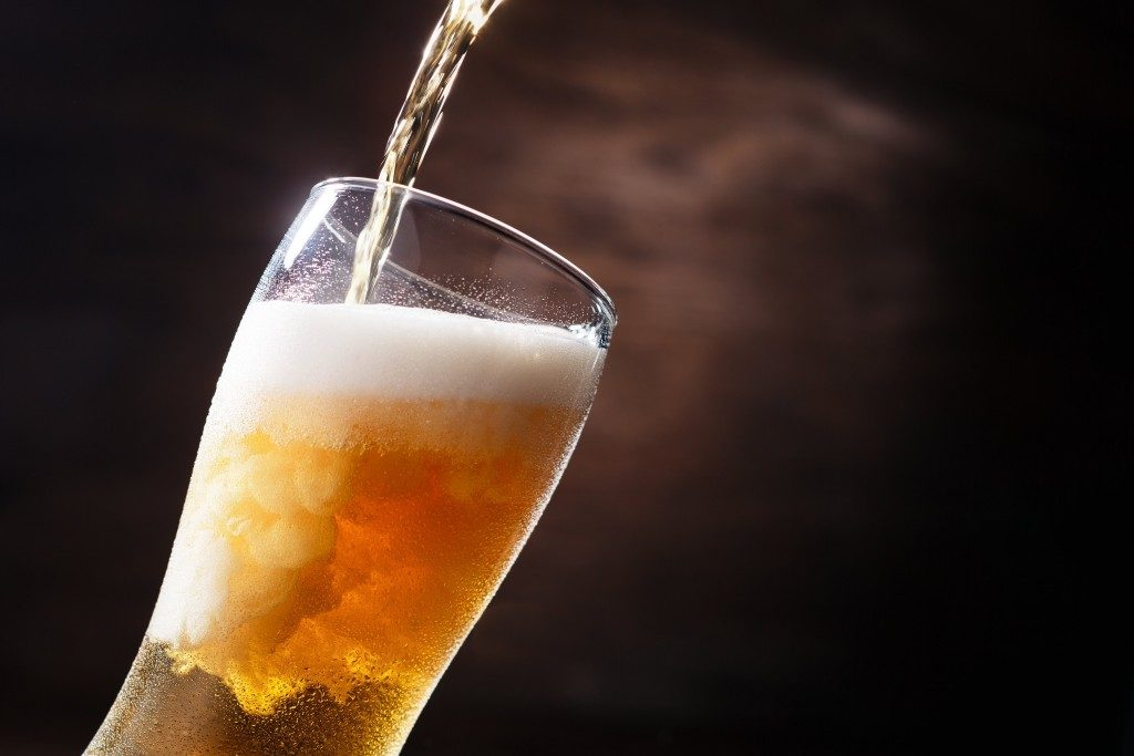 pouring beer in a glass