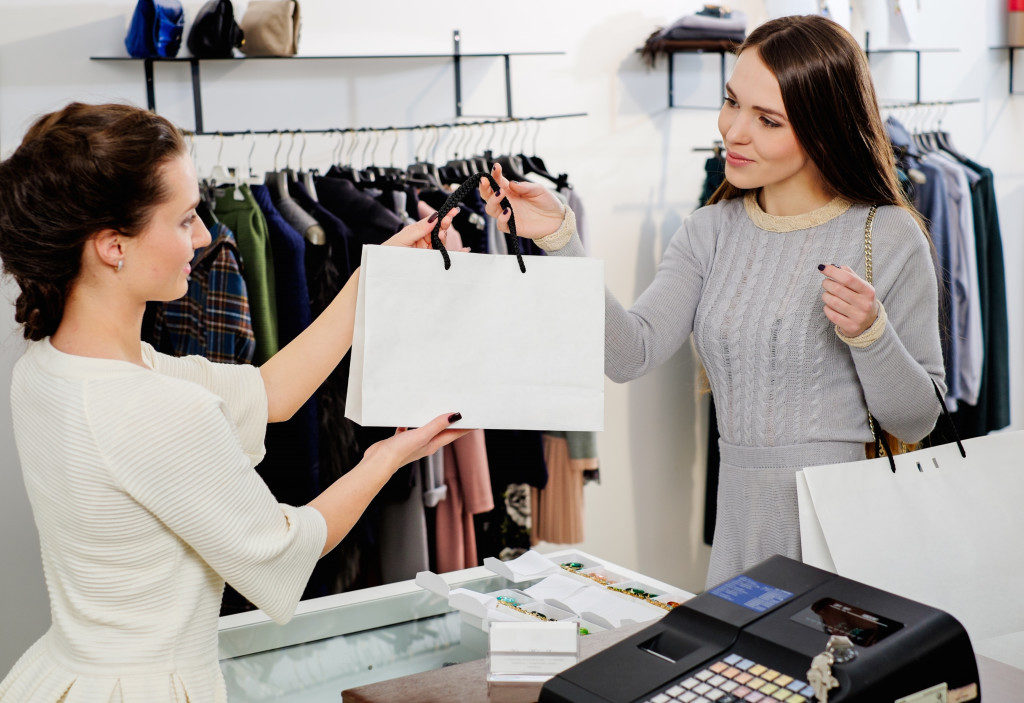 woman buying from a clothing shop