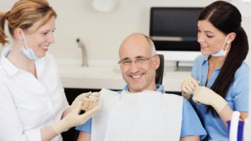 Dentist explaining implants to patient