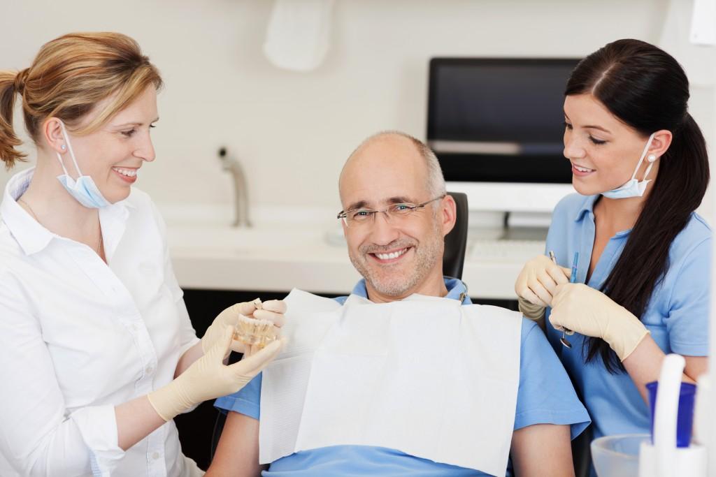 Dentist explaining implants to patient
