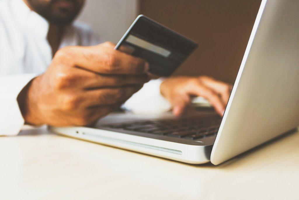 man entering credit card details