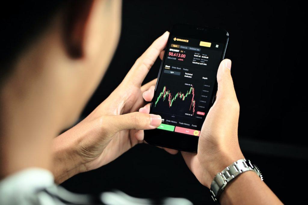 man checking the stock market